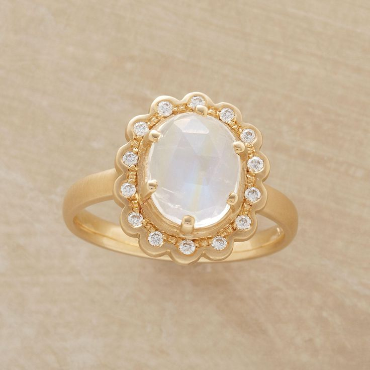 MAGNUM OPUS RING -- Anne Sportun's magnum opus moonstone ring, with moonstone shooting off rainbows, and diamonds all around radiating brilliance. 14kt matte gold. .14 approximate total carat weight. Exclusive