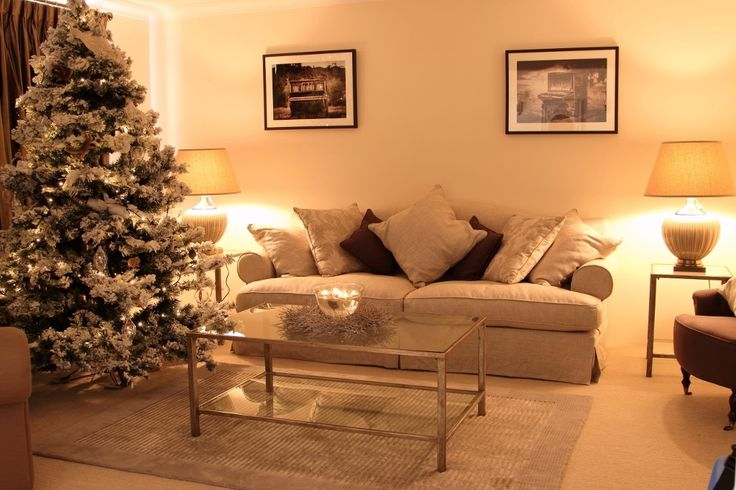 The living room at Christmas time. A beautiful snowy white tree.