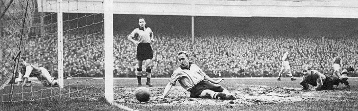 27th November 1954. Wolverhampton Wanderers defender Billy Wright and goalkeeper Bert Williams can only watch as a shot from Arsenal winger Don Roper roles over the line, at Highbury.