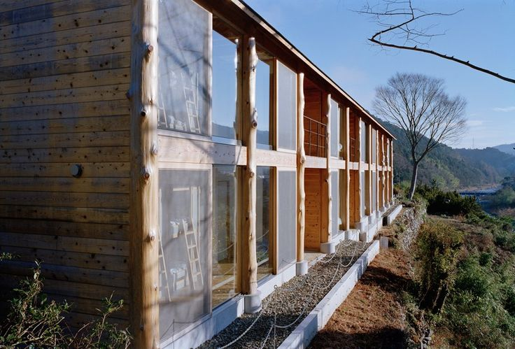 unable to find pillars with a wide enough diameter, satoru ito architects used tree trunks taken the nearby forest to construct the specific timber frame.