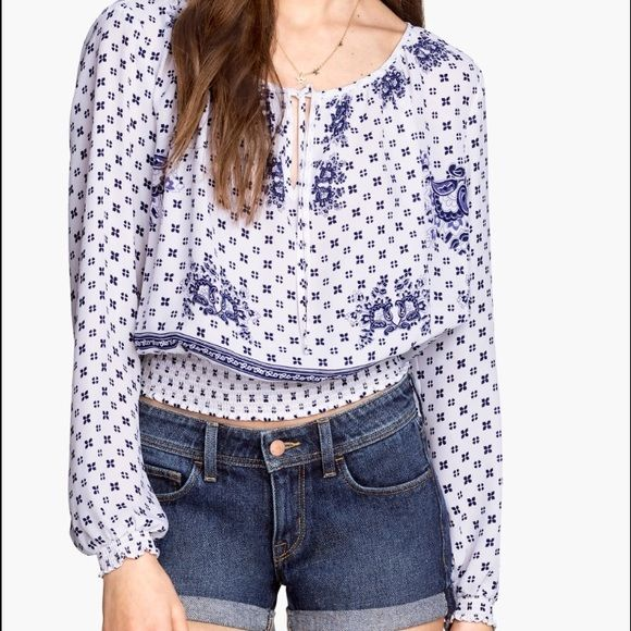 H&M print top NWT. Has some red spots (second  pic)but it's not noticeable.100%polyester. H&M Tops