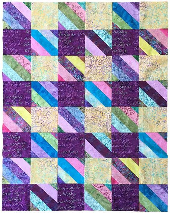 Jelly Roll Check quilt ©Fat Quarter Shop, made by Cheryl Brown. Video tutorial at https://blog.fatquartershop.com/2017/04/new-shortcut-quilt-jelly-roll-check.html