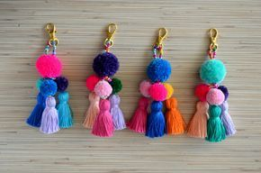 Pom pom keychain Pom pom bag charm Tassel keychain Purse Charm Boho keychain Handbag charm Tassel clip Pompom key chain Neon pink Mint  Colorful bag charm / key chain made of hand crafted pom poms and tassels. Available in 4 colors: hot pink, purple, mint and blue. One size.  Length: approx. 5.9 inches / 15 cm  ♥ Heartmade item ♥  All my products come in a nicely crafted wrapping, so they are ready to be given as gifts.  Every piece of jewelry is made in a smoke and pet free environment…