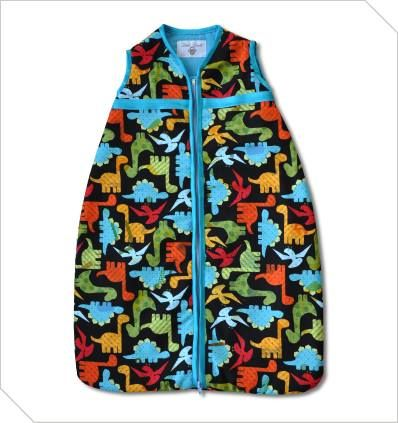 Dinosaur Baby sleeping bag in size 0-6 months R350. Comes with black background or navy blue. Cotton outer with cosy inner batting.