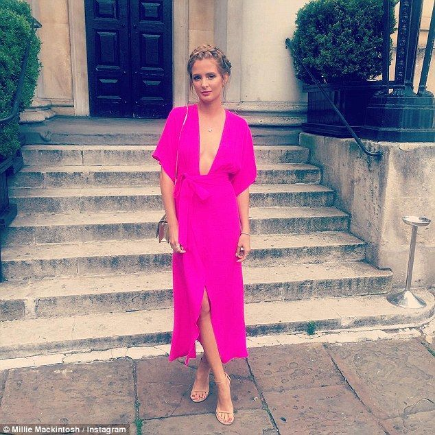Bright move: The former Made In Chelsea star added another, dressed in a vibrant fuchsia coloured dress with a plunging neckline which drew attention to her cleavage