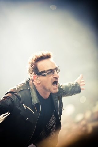 Bono seen here, thanking God himself with a man-hug.