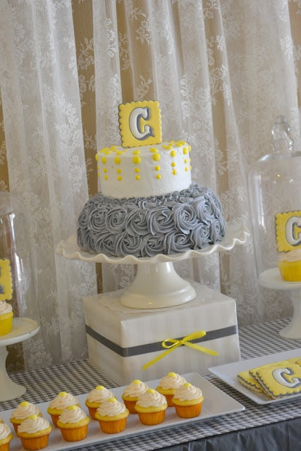 Love this cake yellow and gray cake.  The rose icing is a lovely touch.