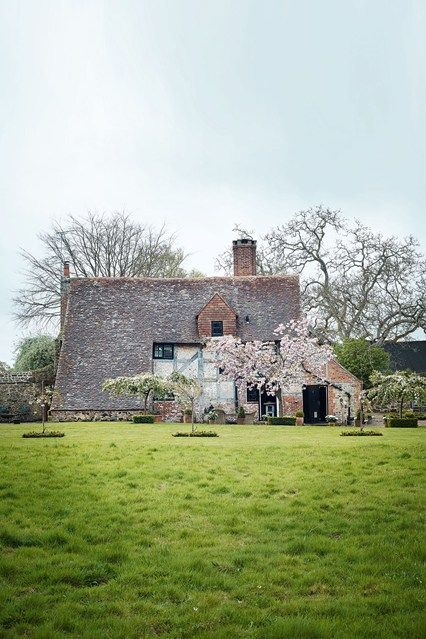 When interior designer Harriet Anstruther took possession of her run-down Sussex farmhouse, she put her eclectic mark on it, while keeping its original features.
