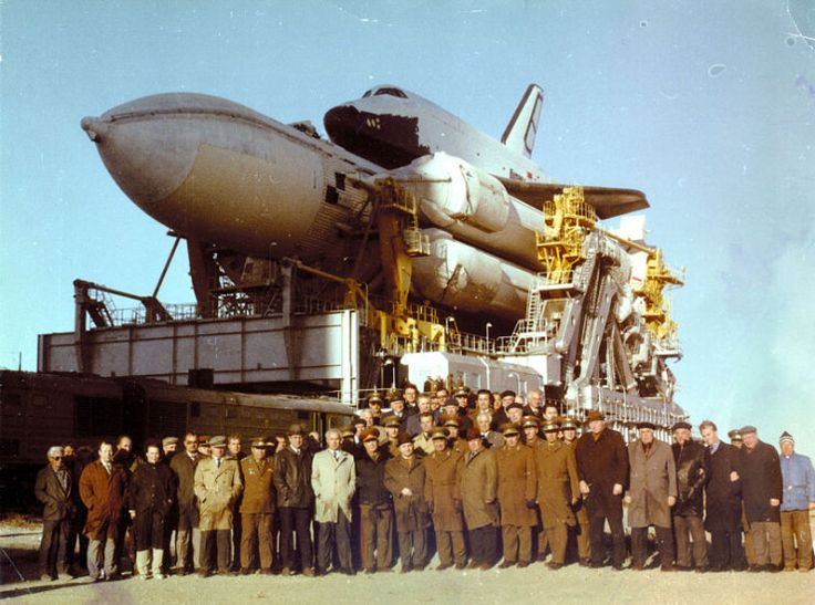 The Russian space shuttle programme was terminated completely even before America ended their shuttle programme /here the technicians responsible for Buran got a group shot photo for posterity (rumours persist that Russia still have MILITARY shuttles ,believed as insurance for Russia for catastrophic meteor/asteroid impending strikes on Russian soil (pays to have such insurance as takes too long to make shuttles at short notice and asteroids invisible if come in from behind the sun direction…