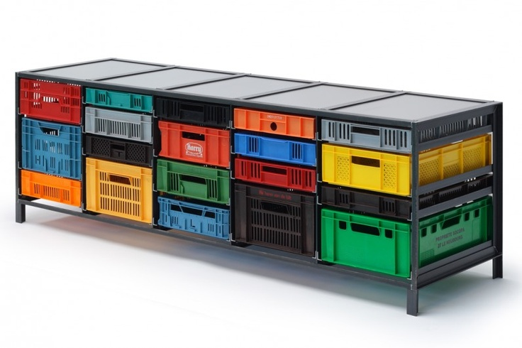 CRATES CABINET by Mark van der Gronden. The series of cabinets, Krattenkast (crates cabinet), is a simple design concept: a steel frame with multicoloured, second hand crates, which act as drawers in the steel construction.