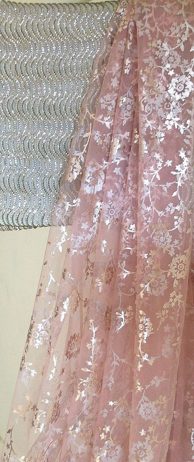 A personal favourite from my Etsy shop https://www.etsy.com/in-en/listing/261793418/blush-pink-tulle-net-saree-with-silver