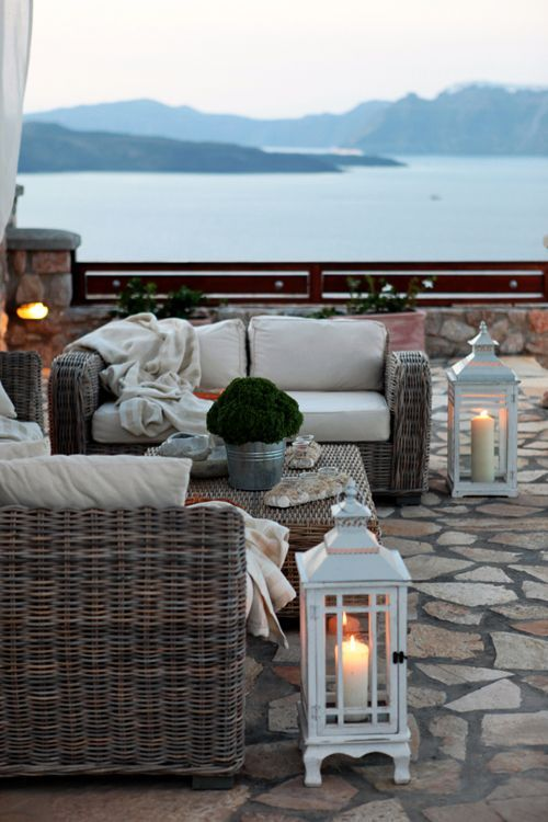 Ahh perfection <3 Stone patio or ceiling top, whicker furniture with blankets and cushions, wooden coffee talbe with plants and natural items, a blowing curtain in the background, lots of lights, railings, maybe add in a fire pit, and those GORGEOUS white lanterns with pillar candles and the ocean as a backdrop.