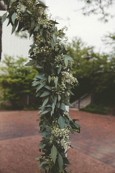 Green wedding ceremony arch decor - greenery and Queen Anne's lace wrapped around arch {Lightbloom Photography}