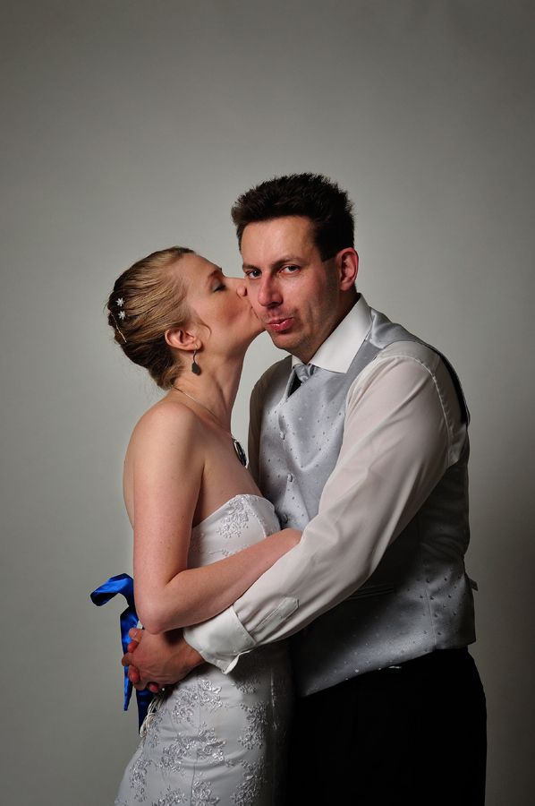 bride and groom - kiss on the cheek