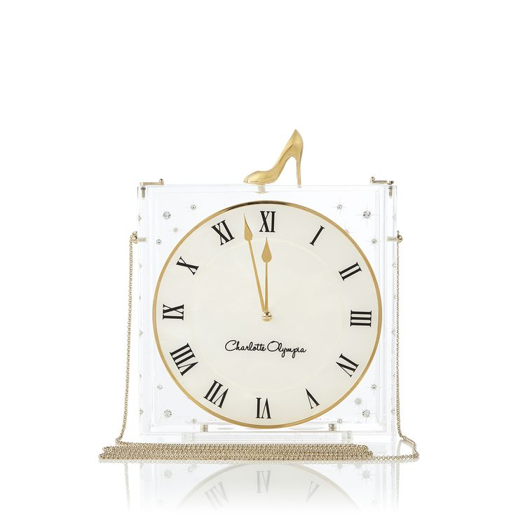 Keep track of the evening with Time Piece. This elegant transparent plexi box features a gold shoe clasp, Swarovski crystal detailing, and a beautiful pearlised clock face. Lucky for you, the clock is frozen at a few minutes before midnight, so the magical spell never lifts.