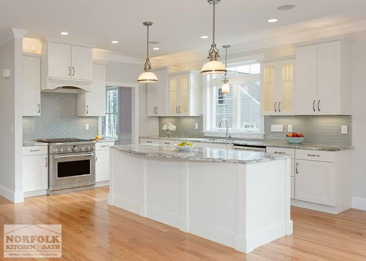 This kitchen by Showplace was designed by Cathy from our Nashua showroom. This transitional kitchen remodel features a white Shaker style door with granite countertops, a gray tile backsplash and stainless steel appliances. This kitchen was part of a new home construction in Bedford, MA. Cathy also designed three bathroom vanities for this home.  Cabinets: Showplace Pendleton 275 …