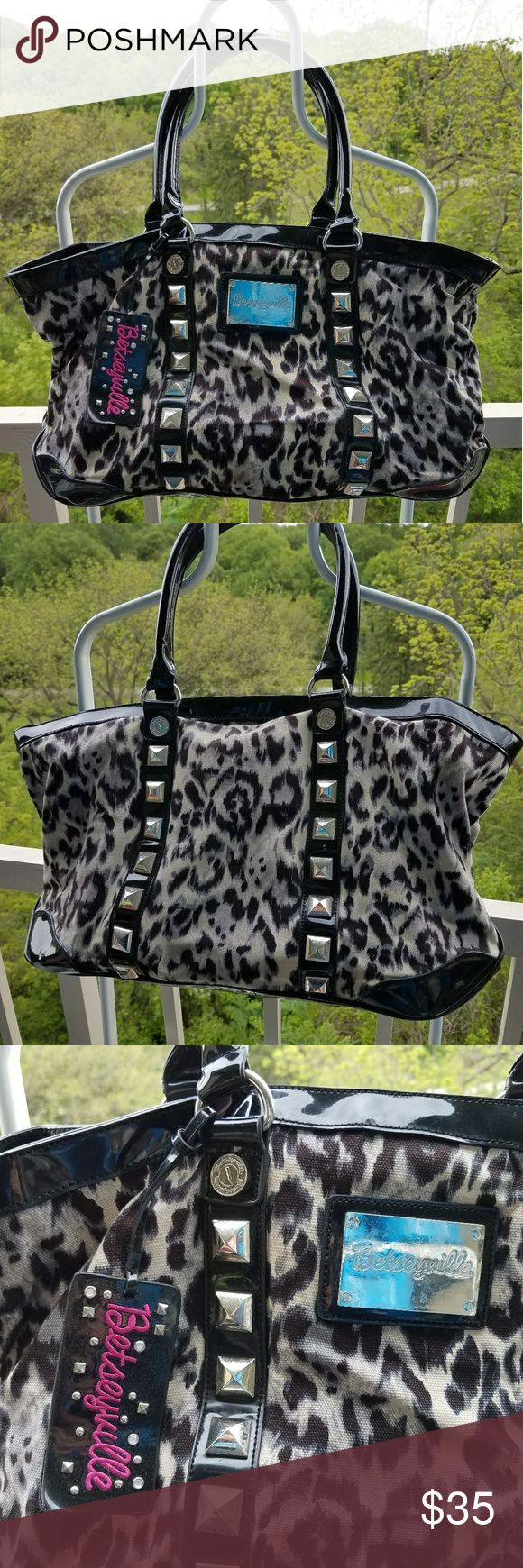 Betseyville Large Animal Print Shoulder Bsg Betseyville Large Animal Print Shoulder bag eith metal studs.  Great statement purse. Small amount of fraying on one handle. Great bag for spring summer. Betseyville Bags Shoulder Bags
