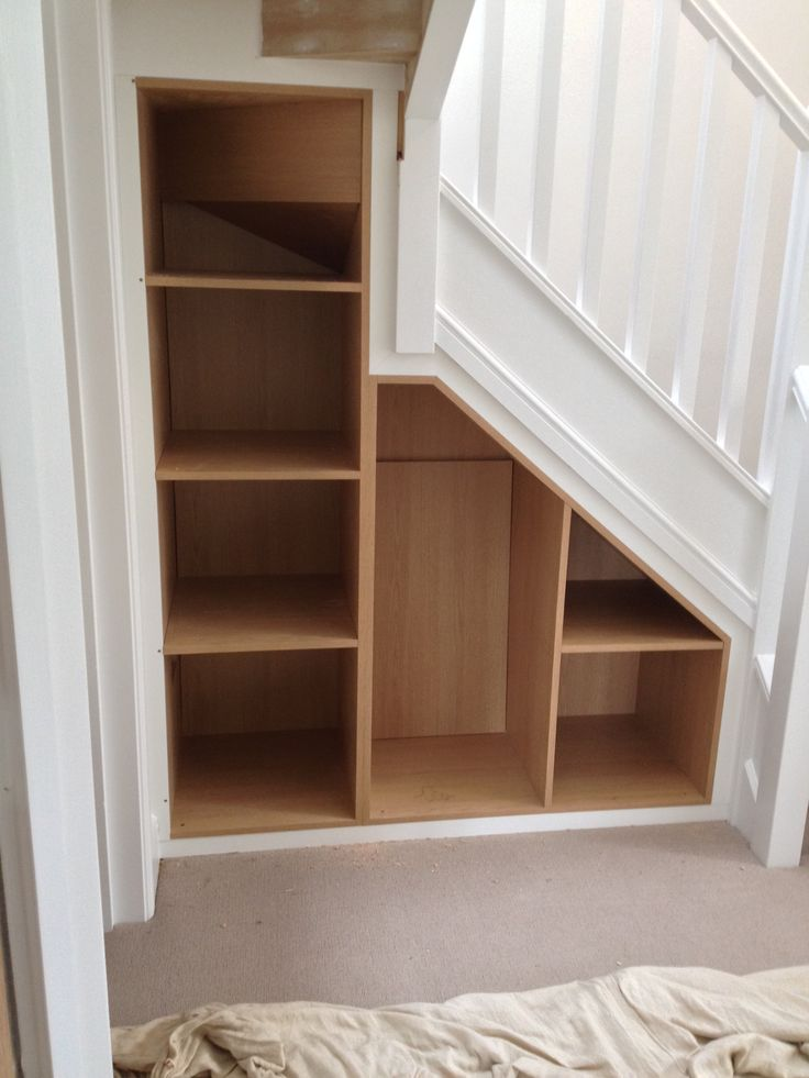 Under-stair storage, perfect use of extra space.    Bespoke Design by Anthony Mullan furniture. Find out more at www.anthonymullan.com