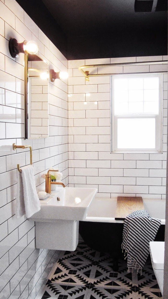 Love the dark ceiling + white tile wall and patterned floor