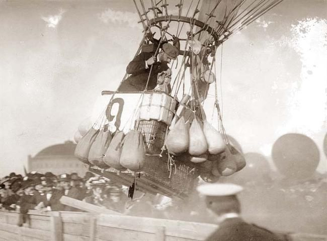 """This picture was taken in 1908, and shows the start of a balloon race in Berlin, Germany.  Pictured is the American entry, the """"Conqueror"""".  I don't see any burners, so the balloons are probably lighter than air gas balloons. Gas balloons were popular earlier than hot air balloons."""