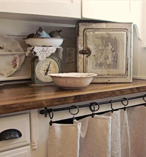 Take off the lower cabinet doors, add a curtain rod and drop cloth curtains - old fashion country appeal.