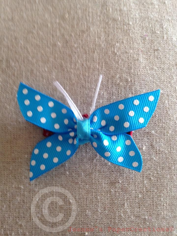 A ribbon butterfly hair clip made by Joanne's Papercreations.