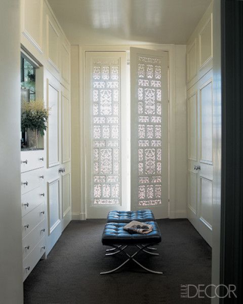 Gorgeous dressing room shutters/doors made from antique Indian screens (interior design by Fisher Weisman via Elle Decor) #closet #dressing_room