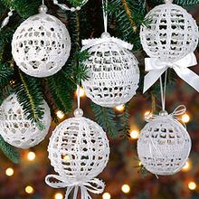 Leisurearts online provides crochet christmas ball pattern with christmas snowballs. Tiny pearls add a lustrous glow to these wintry snowballs for your Christmas tree.