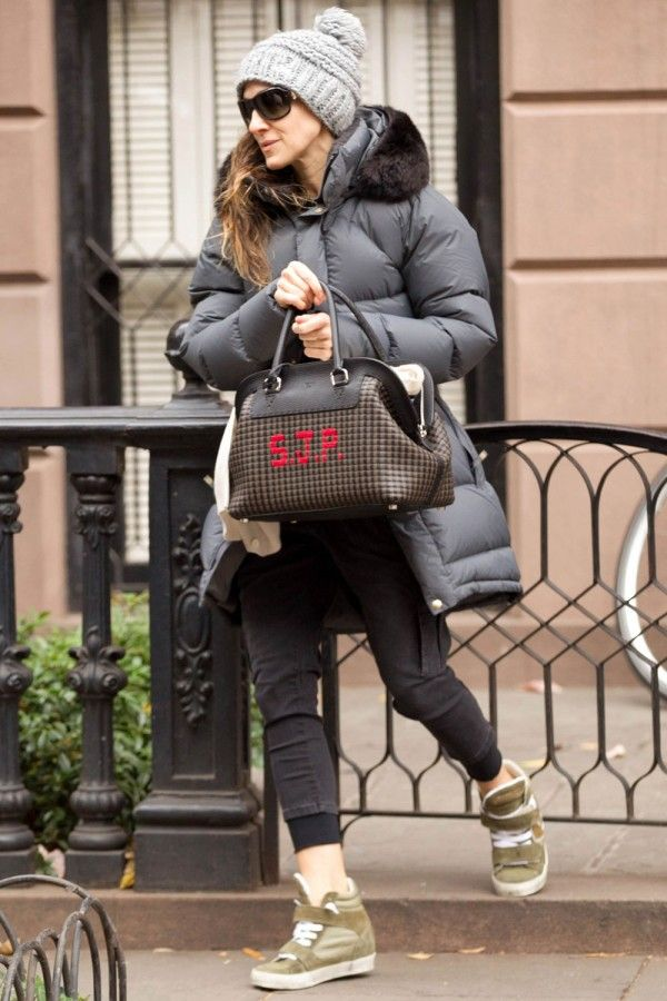 Sarah Jessica Parker doesn't let the New York winter slow her down. She dresses practically in a plush puffa jacket and wedge trainers - and, the must-have accessory, a personalised bag.