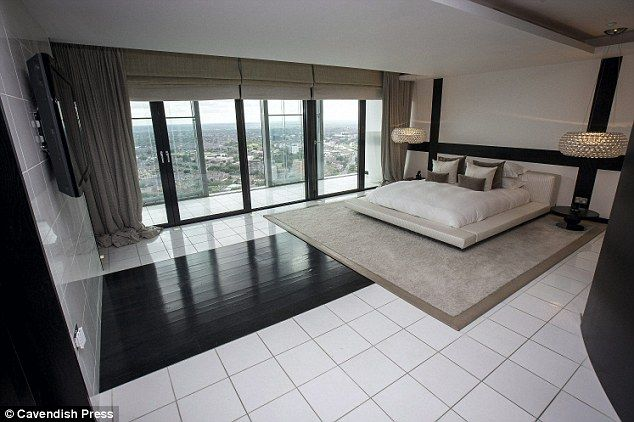 Master bedroom: The apartment also has his-and-hers dressing rooms and chutes which connect each bedroom's laundry baskets to the utility room below