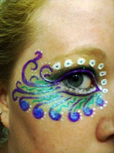 Peacock face paint - one of the better designs I have seen.