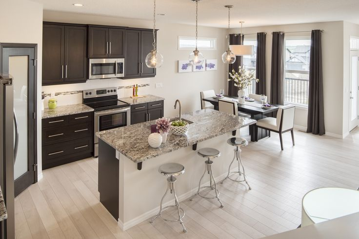 The Drummond Kitchen – Trico Homes – Check out the new homes built by www.tricohomes.com #homebuilder #tricohomes #calgary