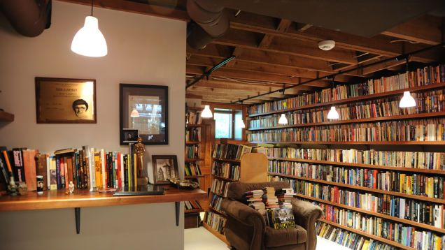 Fantasy author Neil Gaiman's personal library is a book lover's dream, stuffed to the gills with all manner of novels, reference books, and anthologies, with the occasional gargoyle or mounted stuffed head for good measure.