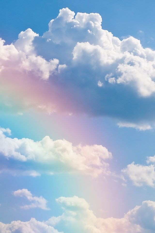 A rainbow with clouds around it