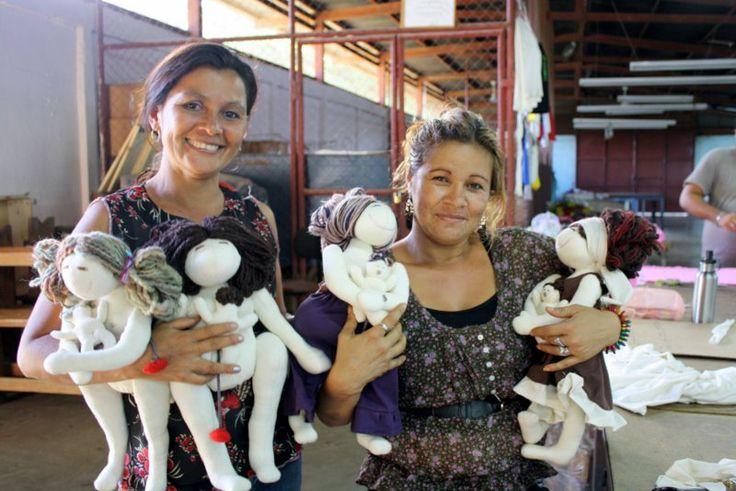 The ladies at Zona Franca Masili, proudly making MamAmor dolls