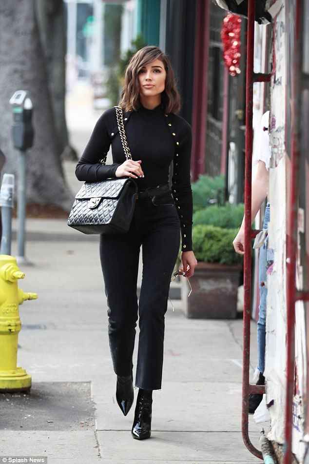 Chanel chic: The former Miss Universe accessorized with a Chanel purse and patent leather ...