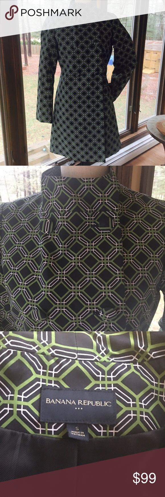 Banana Republic Geometric Print Rain Coat NWOT bold geometric print fully lined Raincoat by Banana Republic.  The green/black/white print pop for Spring!  It is an asymmetrical look that looks terrific on. Banana Republic Jackets & Coats Trench Coats