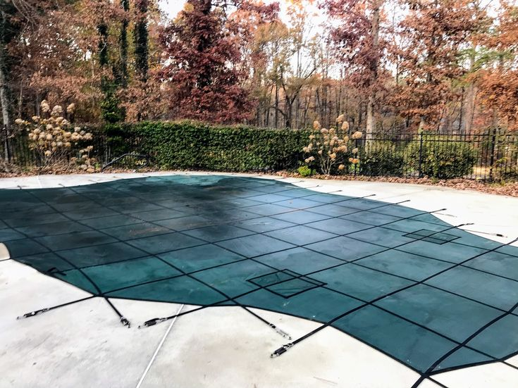An inground swimming pool cover provides a nice break from pool maintenance.