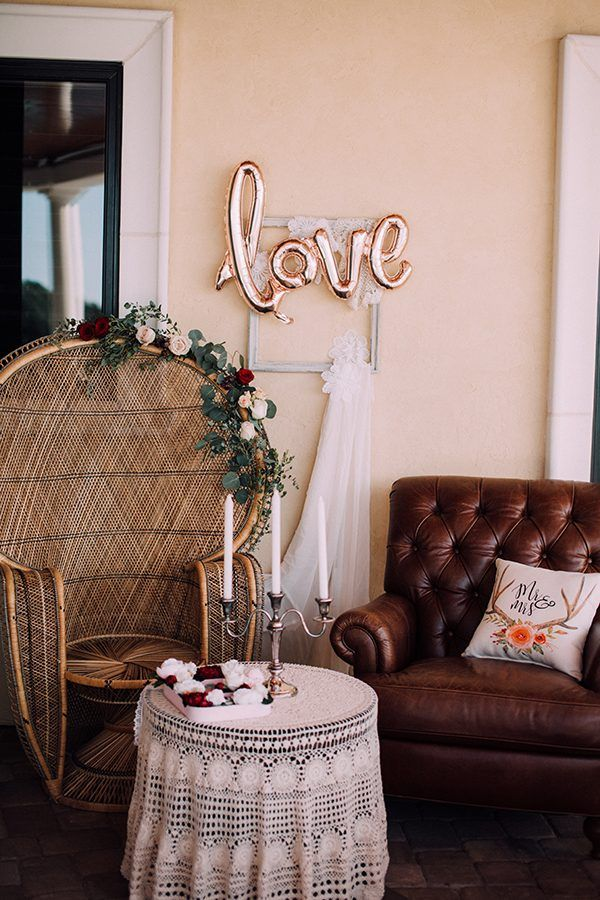 Mismatched chairs at this cute sweetheart table | Photo by  Chelsea Diane Photography