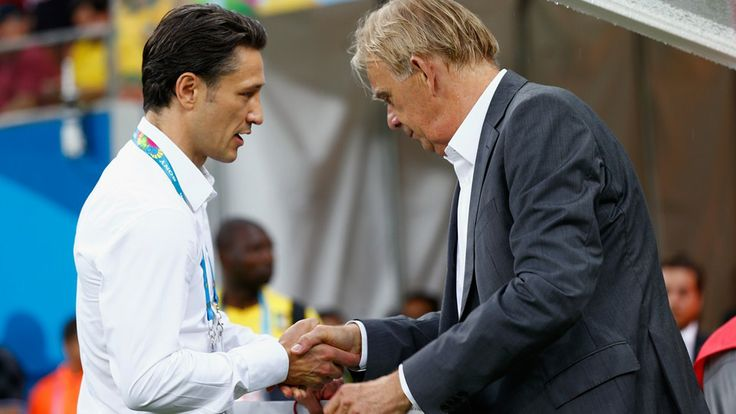 Head coach Niko Kovac of Croatia (L) shakes hands with head coach Volker Finke of Cameroon