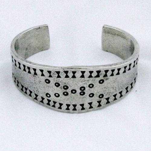 This bracelet is based on a silver one that was found in the Curedale hoard from Lancashire, England in 1840. The stamped design is typical of Viking age silver, as a bracelet such as this would have