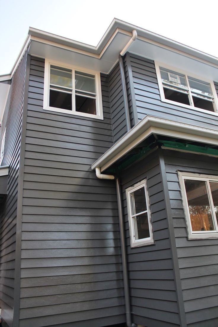 It's a new house! weatherboard exterior Dulux Mt Eden, window trims Vivid White, and Shale Grey for facsias