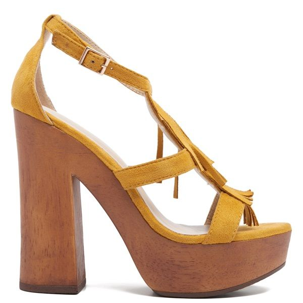 Yellow high-heel sandal with suede texture. Features wooden chunky heel and fastens with adjustable ankle strap.