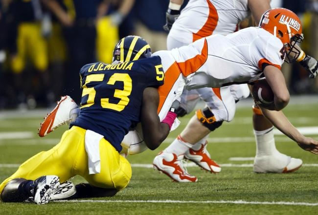Denard Robinson threw for two scores and ran for two more as the 25th-ranked Michigan Wolverines trounced their conference foes, shutting out the Illinois Fighting Illini at the Big House, 45-0.