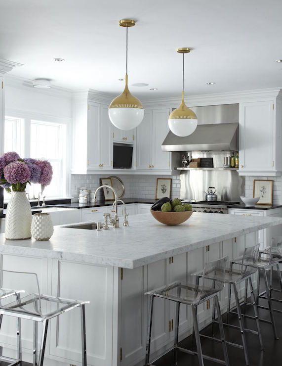 White kitchen with brass pendants, Robert Abbey Rio Pendants.