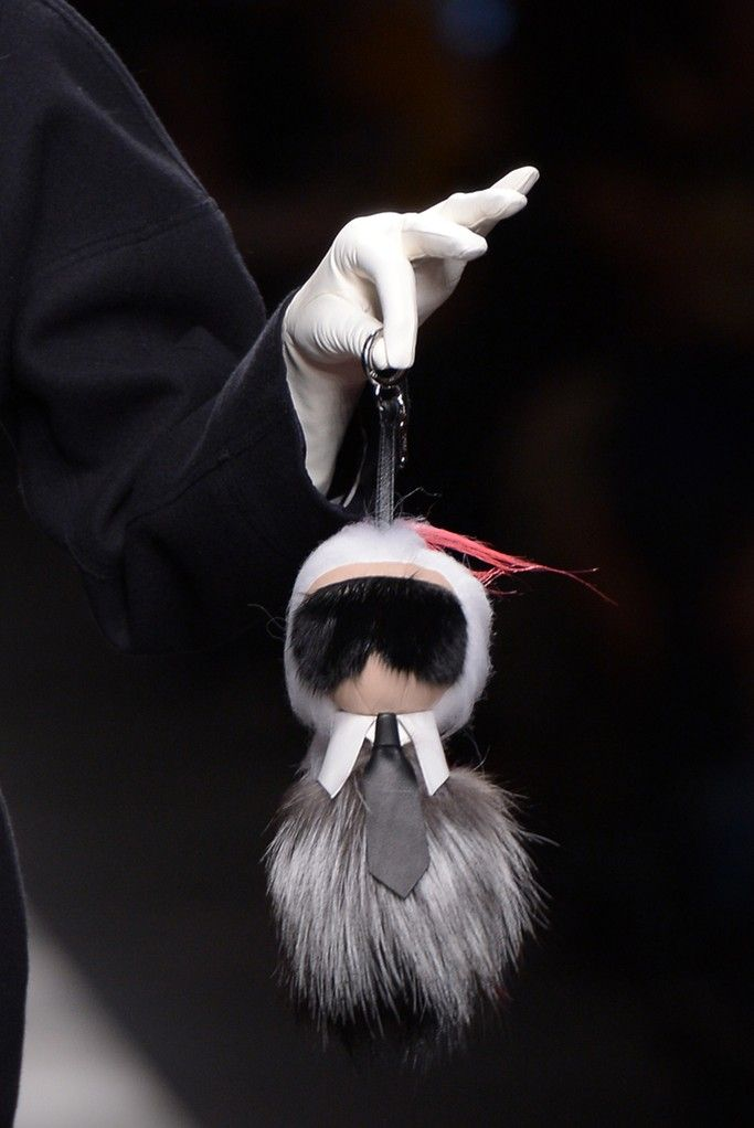 Fendi's furry Bag Bugs are a symbol of cool, and for fall, they just got cooler. This new mini-Karl Lagerfeld charm, designed in three kinds of fur, stole the show on the Thursday runway. [Photo by Davide Maestri]