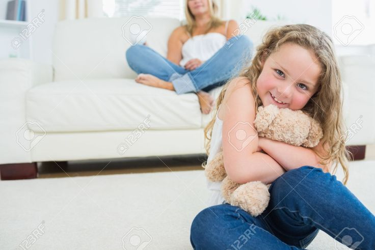 16075884-Daughter-hugging-her-teddy-bear-while-her-mother-is-resting-on-the-sofa-Stock-Photo.jpg (1300×868)