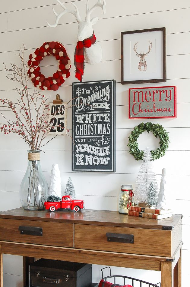 A classic red, white and gray Christmas entryway gallery wall! www.littlehouseoffour.com https://emfurn.com/
