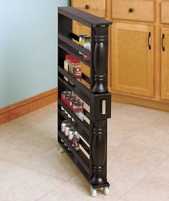 Get maximum kitchen storage in a minimum amount of space with the wooden Kitchen Storage Rack. Nearly 3 feet tall, it's just 3-1/2 inches wide, so it fits in between appliances, cabinets and other nar