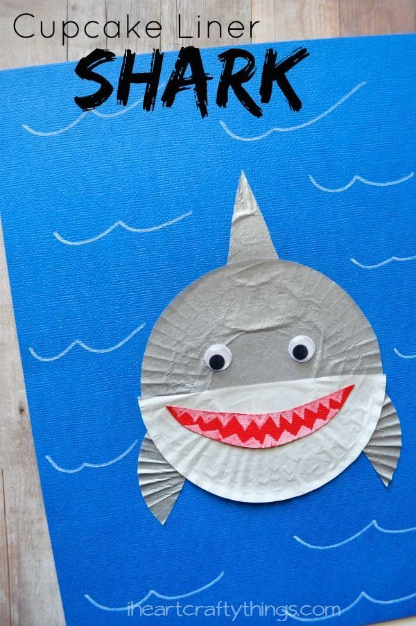 Make an adorable Shark Kids Craft out of Cupcake Liners. Perfect craft to go along with a children's shark book or ocean theme.